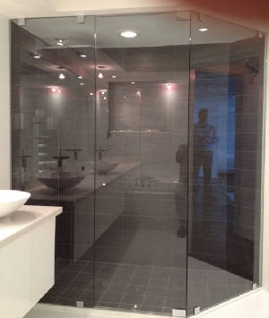 Corner shower with gray glass